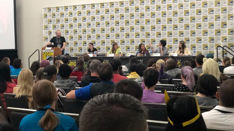 Adron Buske on stage hosting the 10 Points to Slytherin panel at San Diego Comic Con