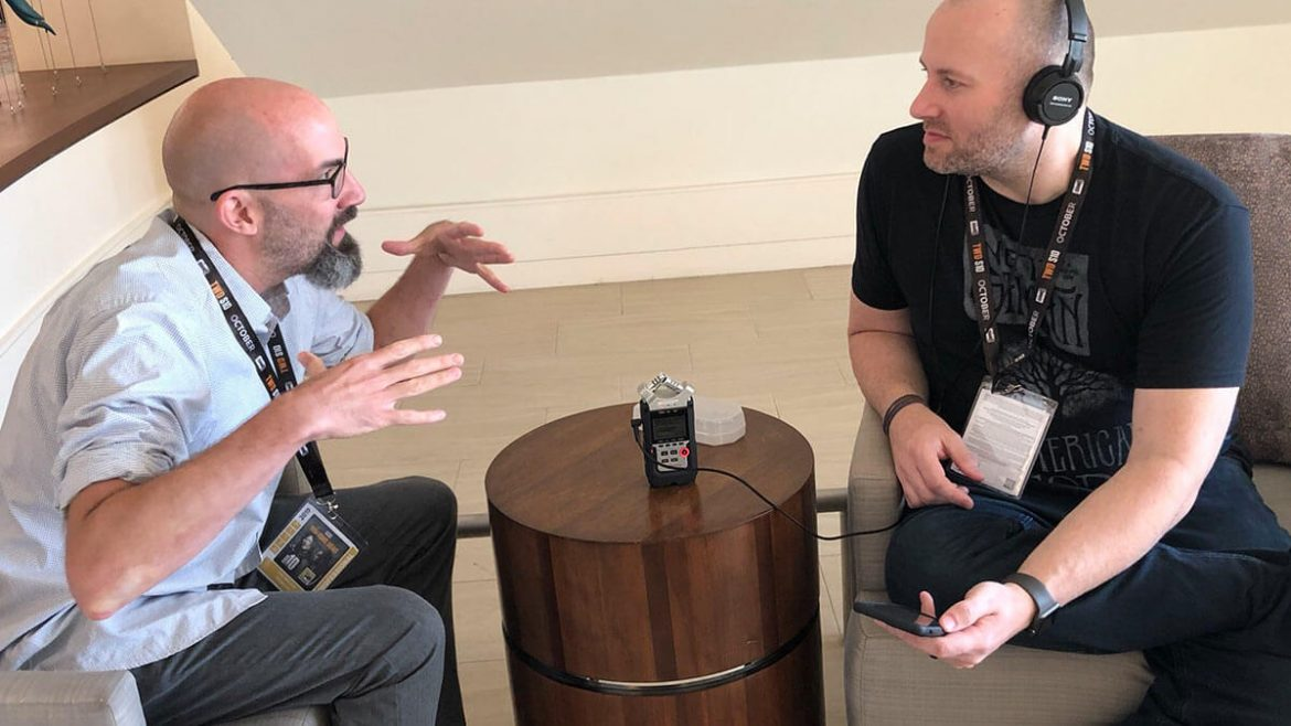 Author Clay McLeod Chapman, being interviewed by Fictitious podcast host Adron Buske at San Diego Comic-Con 2019.